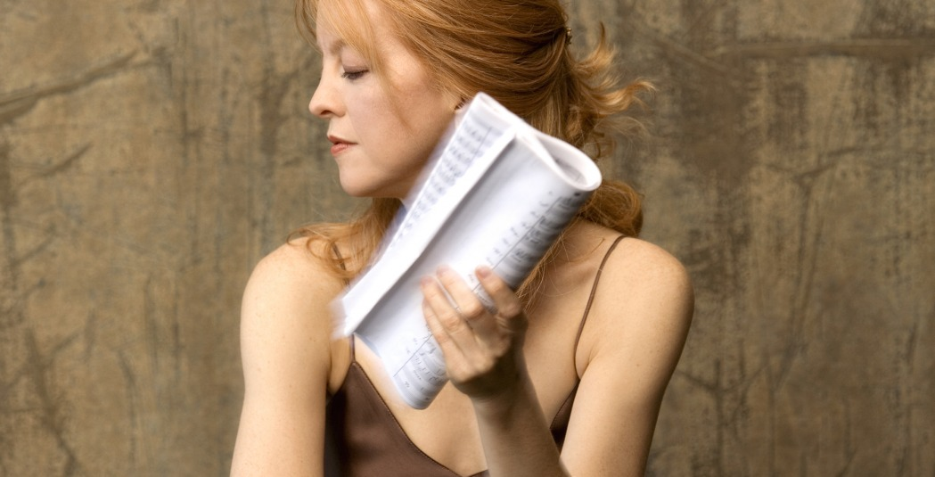 Maria Schneider in profile holding sheet music