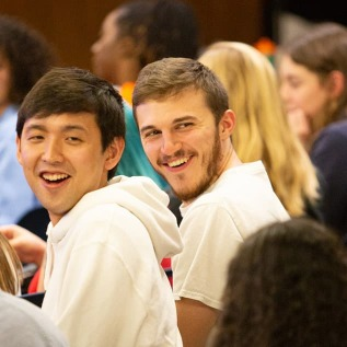 Students smiling during campus event