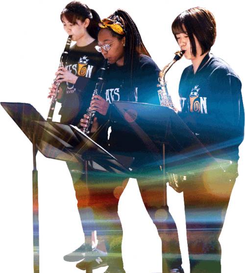 Three students play wind instruments