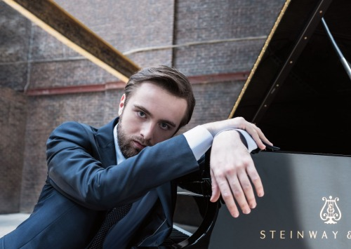 Daniil Trifonov sitting at piano