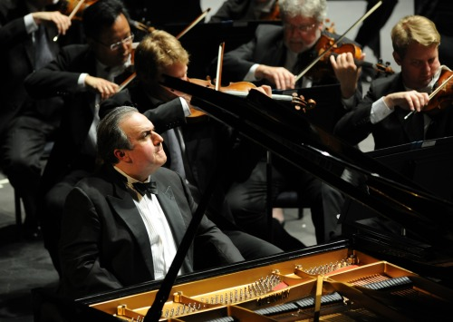 Yefim Bronfman sitting at piano at concert