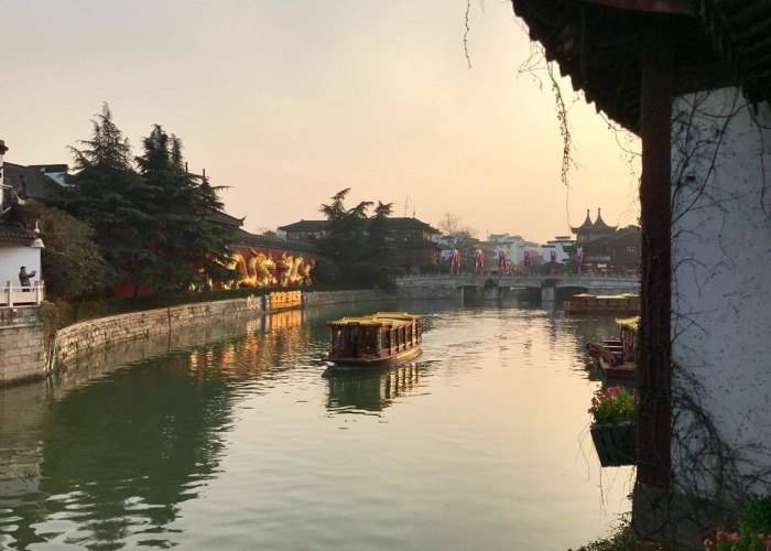 Buildings on either side of a river in Nanjing, China