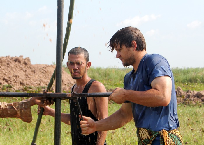 A picture of Michael Schaefer in action at a well in Cambodia.