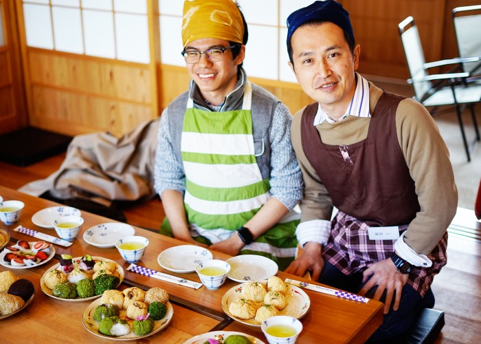 Student cooking with Japanese man