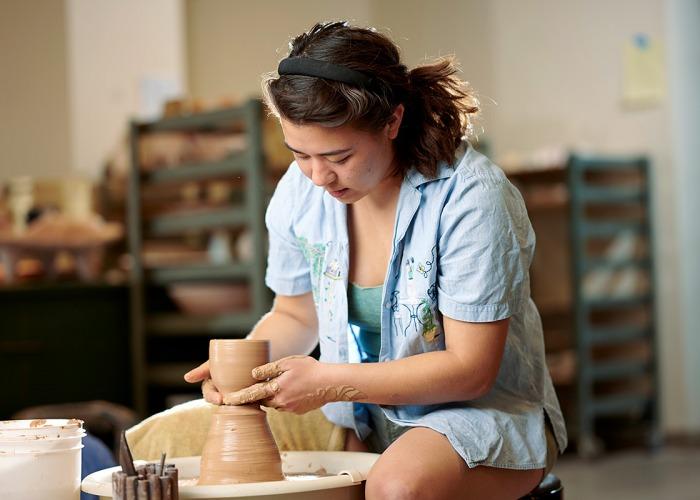 Katelynn Jankowiak at the potters wheel