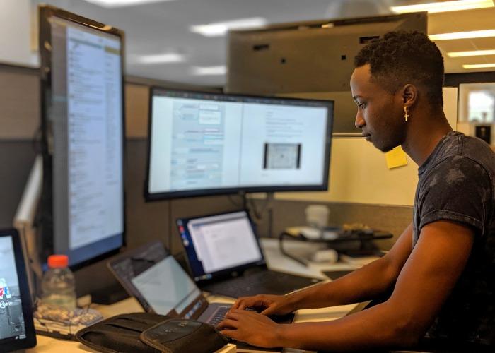 Man at his computer workstation
