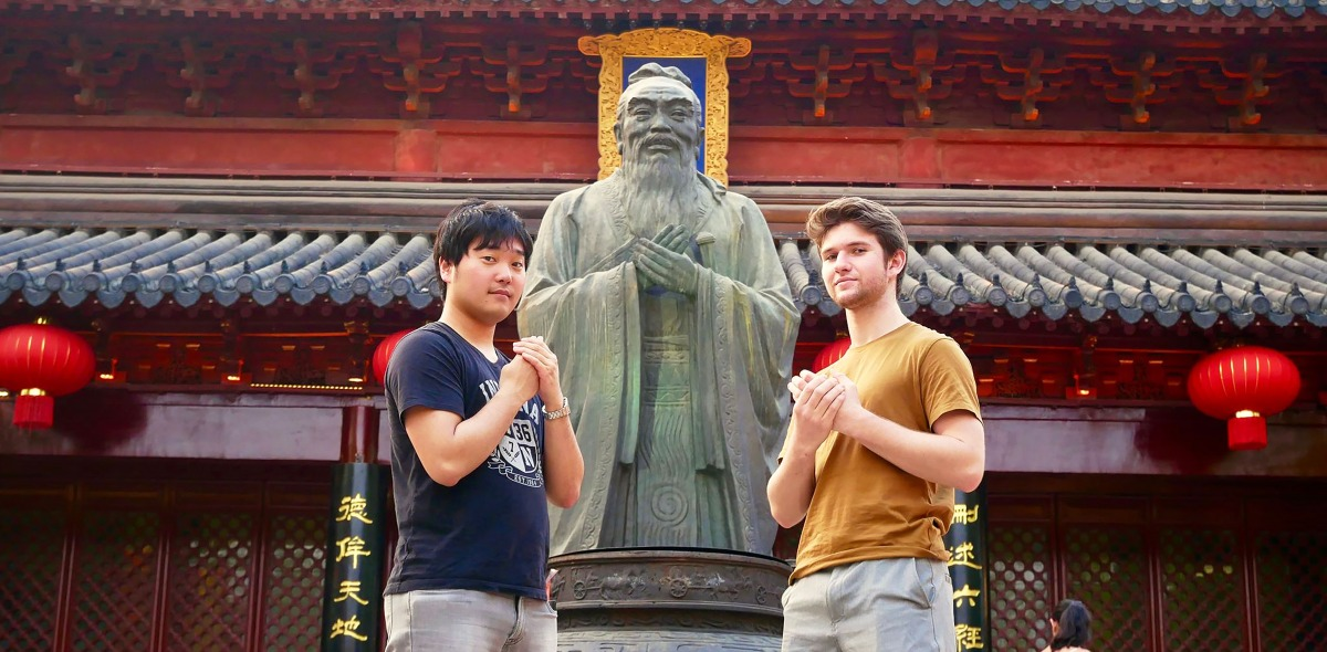 Two students with statue in Shanghai