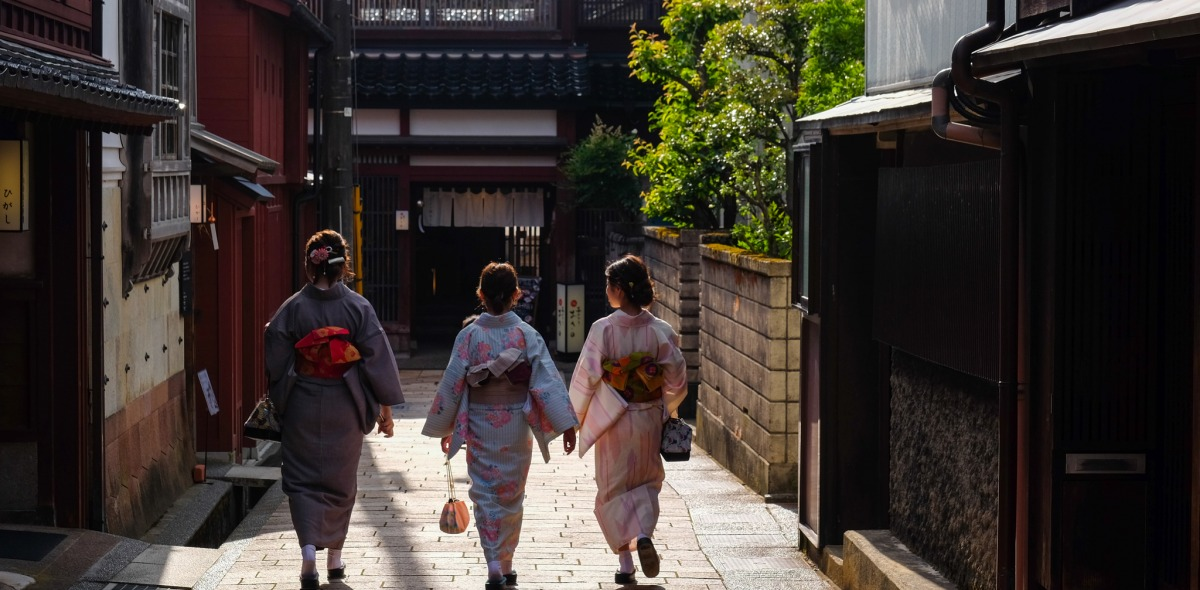 A picture of three women walking down the street.
