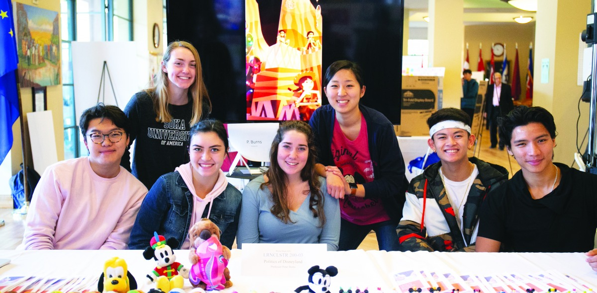 Image of students at a booth at the Learning Cluster fair.