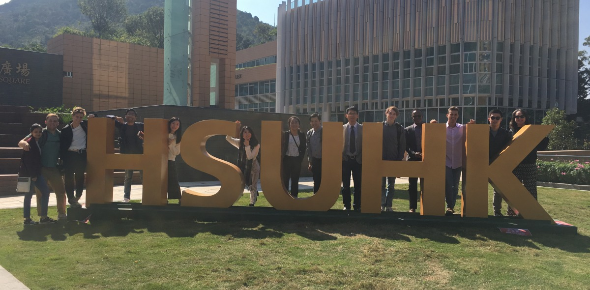 Image of students posing with a large sign in Hong Kong.
