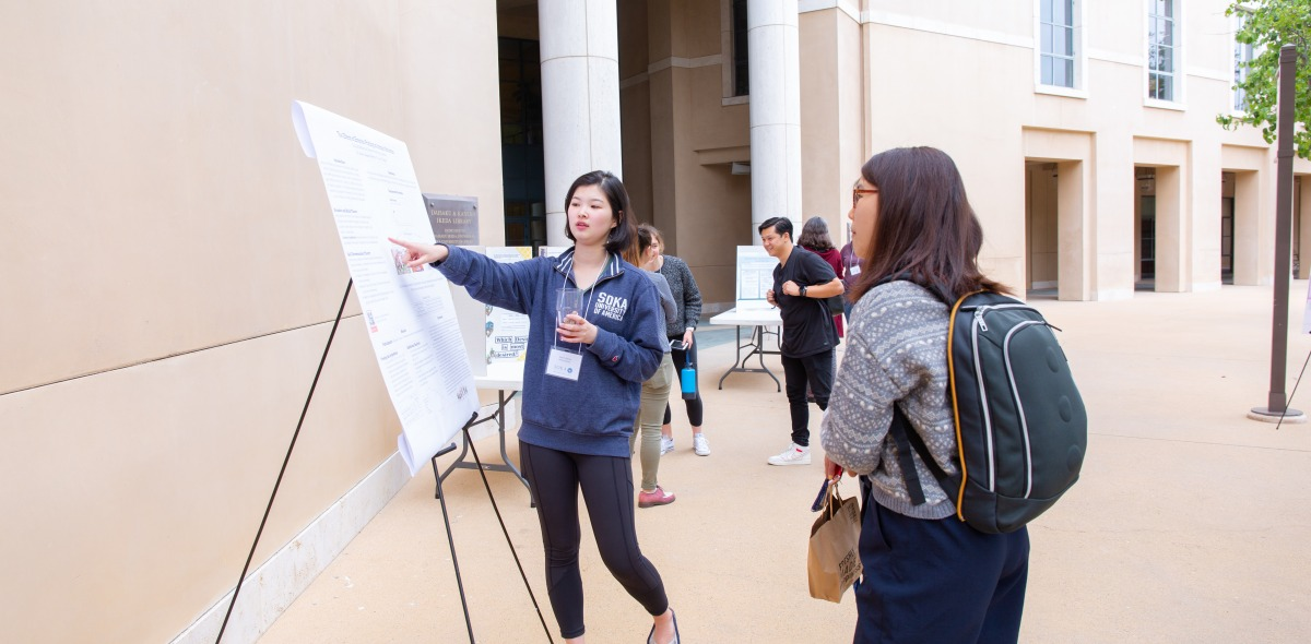 Image of students at poster session.
