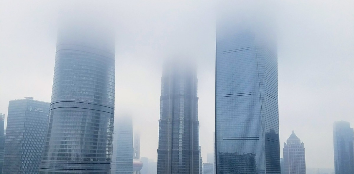 Skyscrapers fading into a thick cloud of smog.
