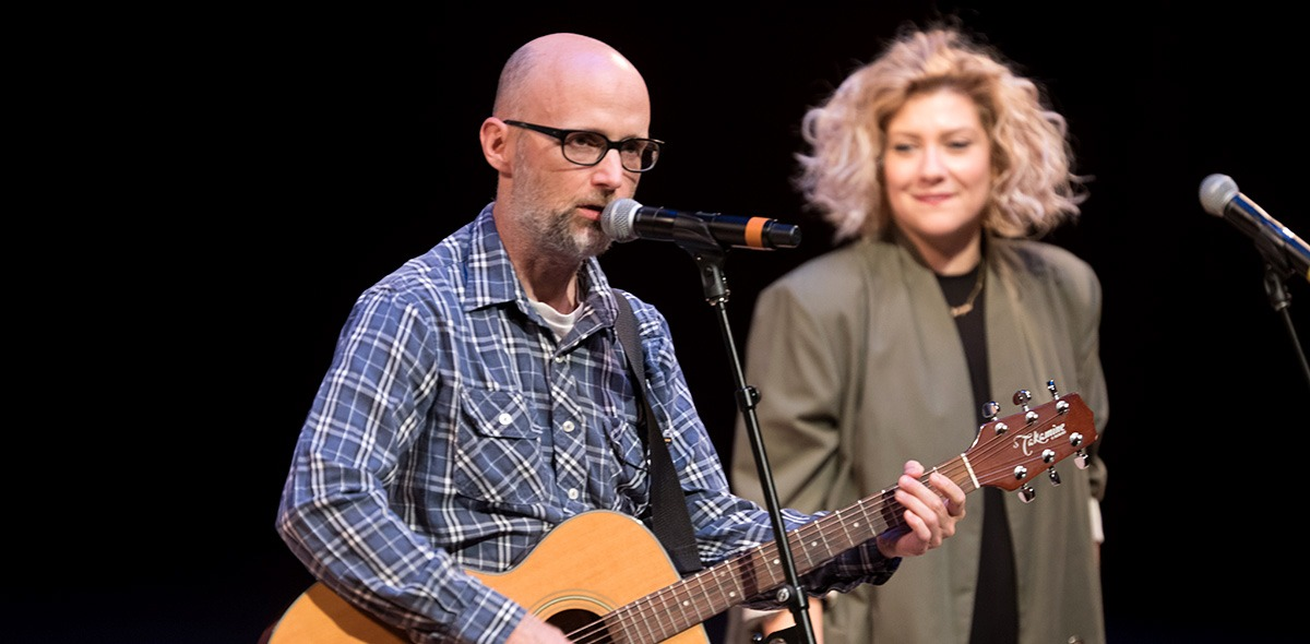 Moby performs with background singer