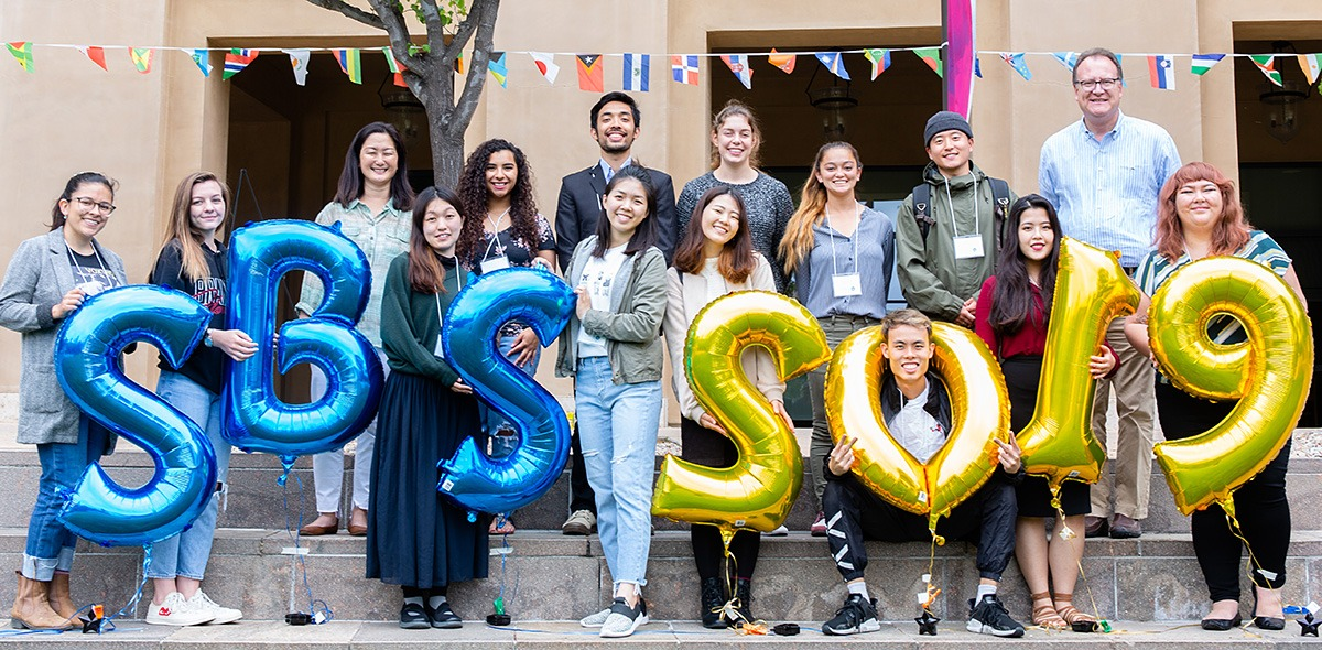 Large group of SBS students posing with 2019 balloons