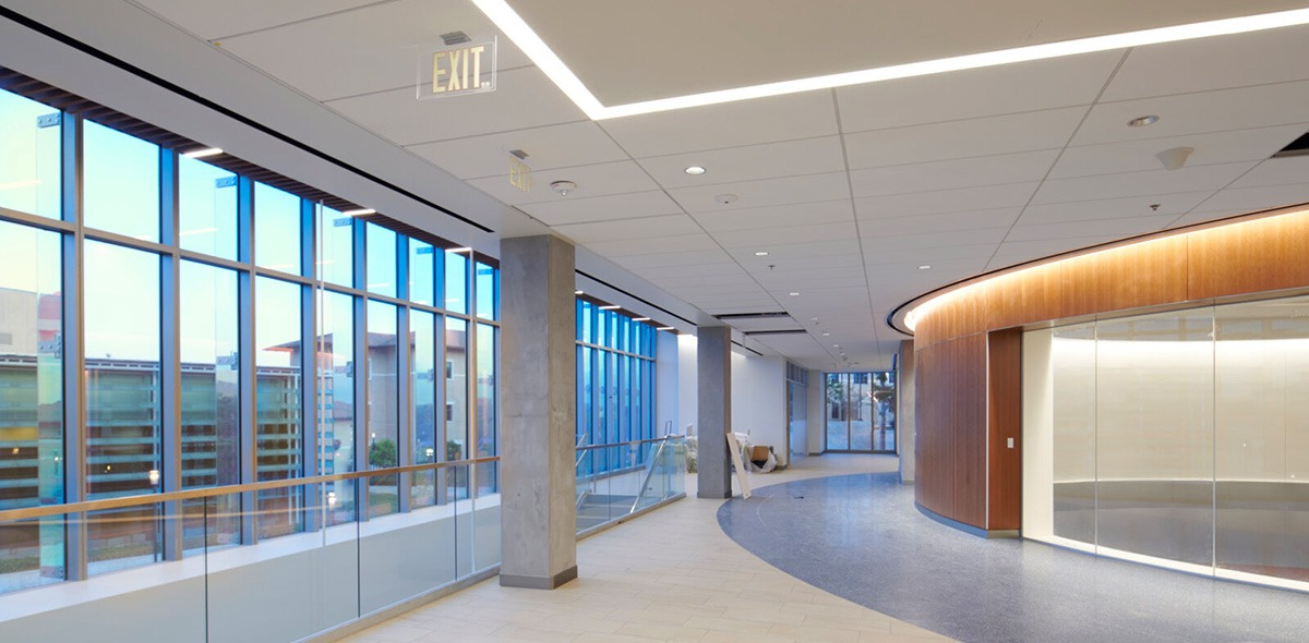 Inside Curie Hall, which features expansive hallways and large windows with views of campus