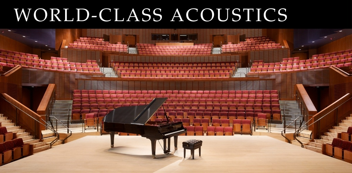 Interior of an Concert Hall with piano in the center of the stage. Text reads: World-Class Acoustics