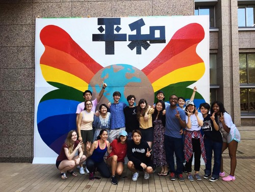Students in front of rainbow mural in Japan
