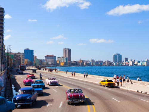 Image of a Havana street overlooking the ocean.