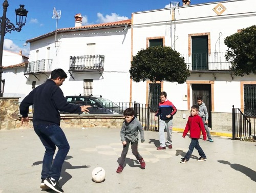 Image of children playing soccer in Seville, Spain.