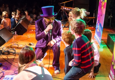 Secret Agent 23 Skidoo performing on stage with kids