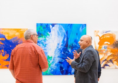 Image of two visitors discussing at the art gallery.