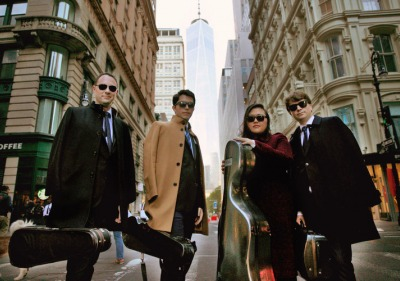 Calidore String Quartet members standing in New York City