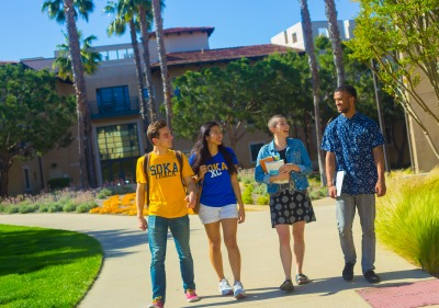 Image of students walking around campus.