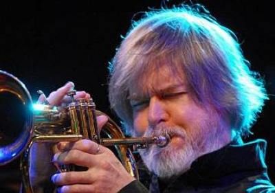 Tom Harrell playing the trumpet in concert