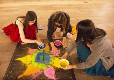Image of students creating art during Diwali