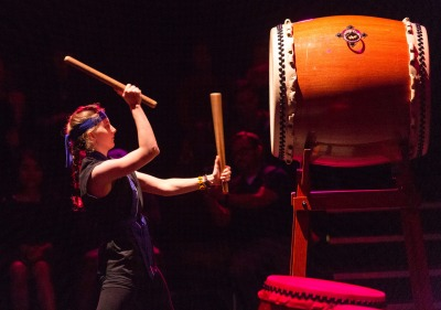 Image of student playing taiko drum