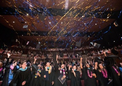 Photo of students with streamers at commencement ceremony