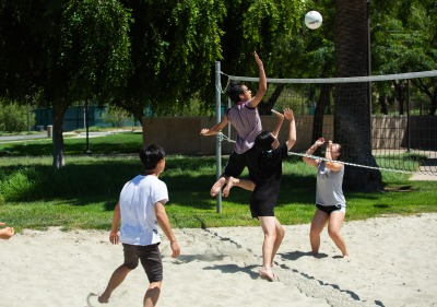 Image of students playing beach volleyball