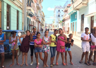 Image of children in a colorful Cuban street.