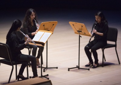 Image of a student musical trio performing in the Performing Arts Center.
