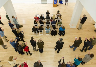 Image of people at an event in the art gallery.