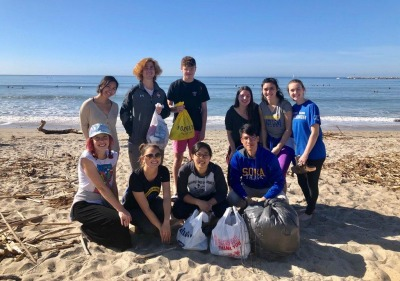 Photo of student-athletes at beach clean up activity