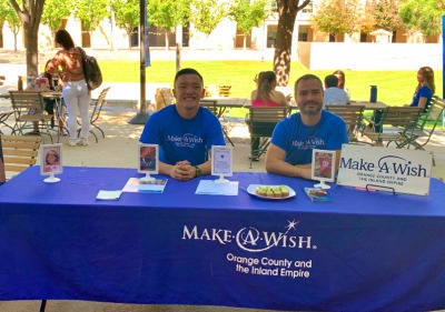 Soka students staff a Make a Wish foundation table