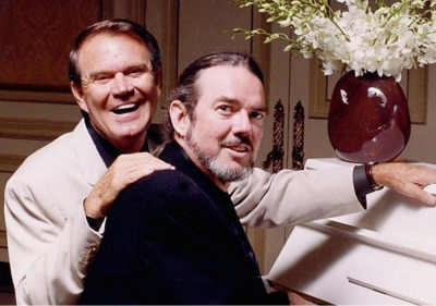 Glen Campbell and Jimmy Webb sitting at the piano