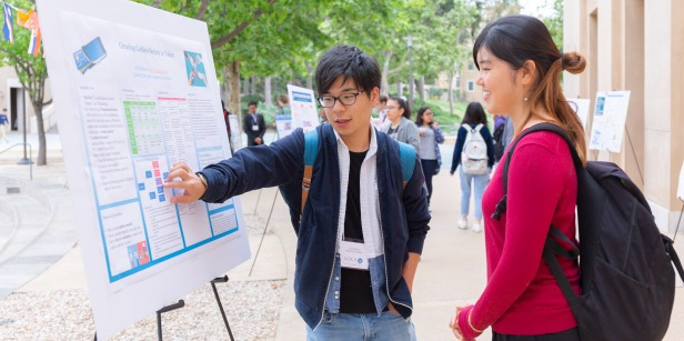 Image of students at the SBS poster session.