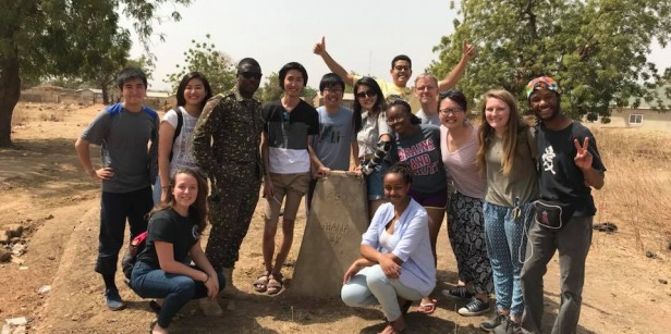 Students gather for group photo during travel learning cluster in Ghana
