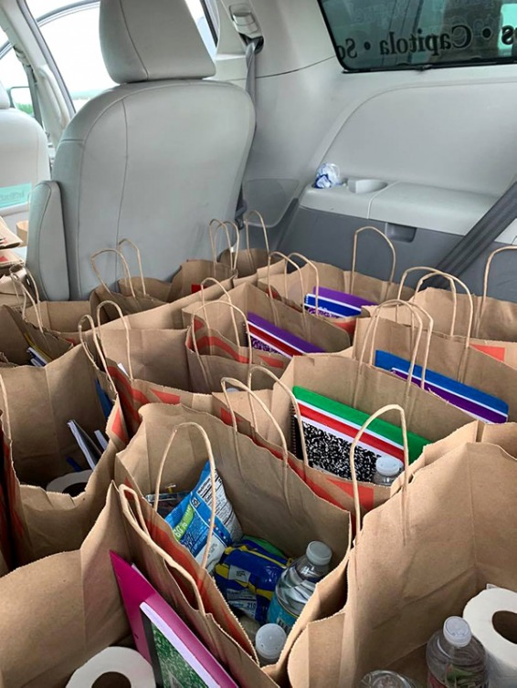 Donation bags in the backseat of a car