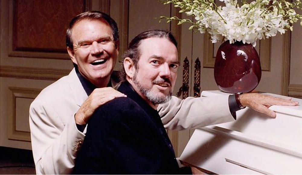 Glen Campbell and Jimmy Webb sitting at piano