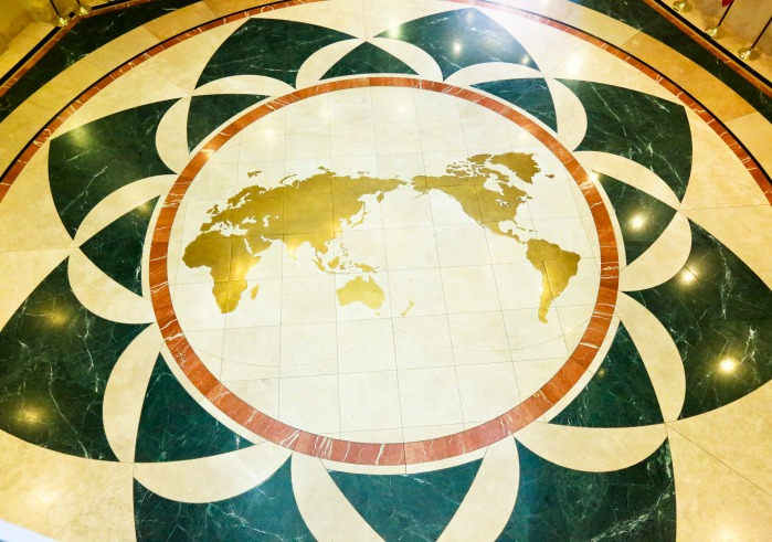 Image of an inverted world map on the floor of Founders Hall atrium.