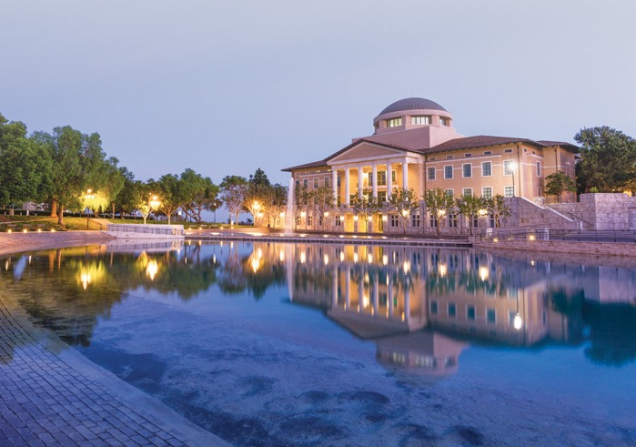 Overlooking Peace Lake at twilight with Founders Hall in the background