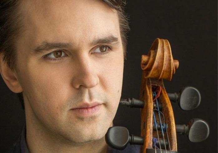 Andrew Janss holding cello