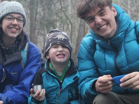 Students with young boy at a nature school
