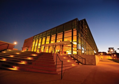 Exterior of Soka Performing Arts Center at twilight