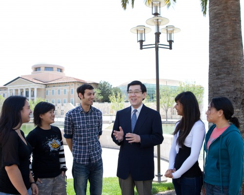 President Danny Habuki with group of students